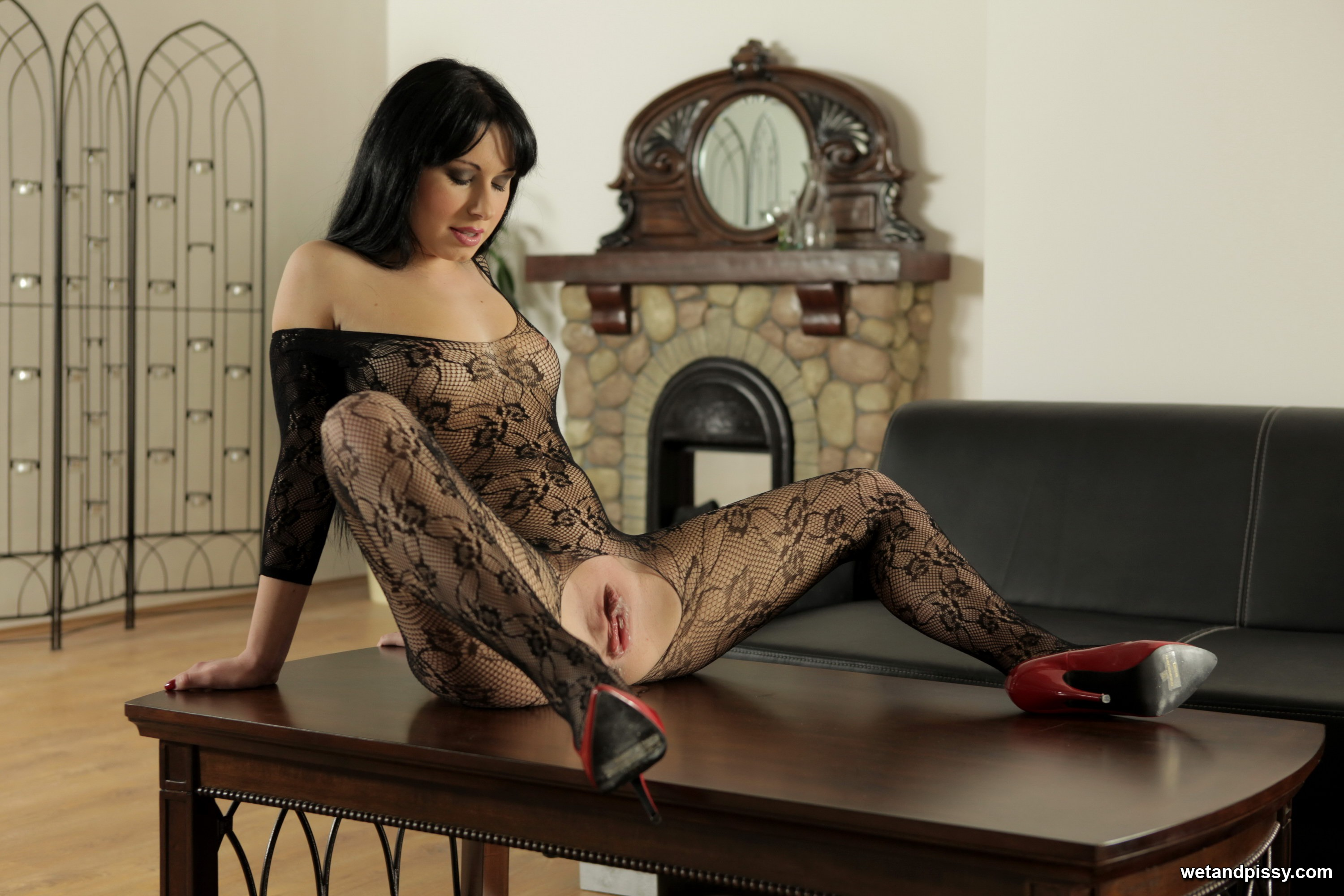 Raven haired beauty with long legs