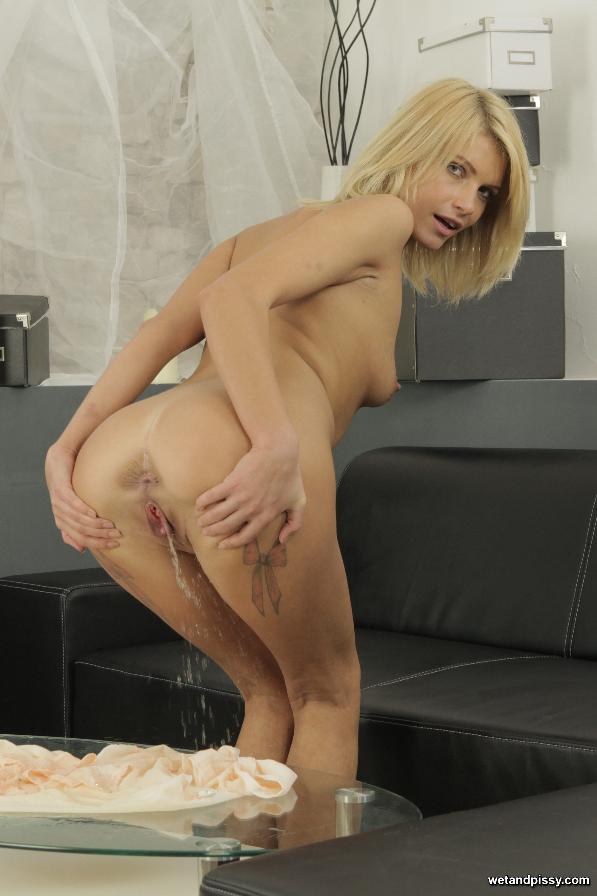 Peeing on her feet and then licking it