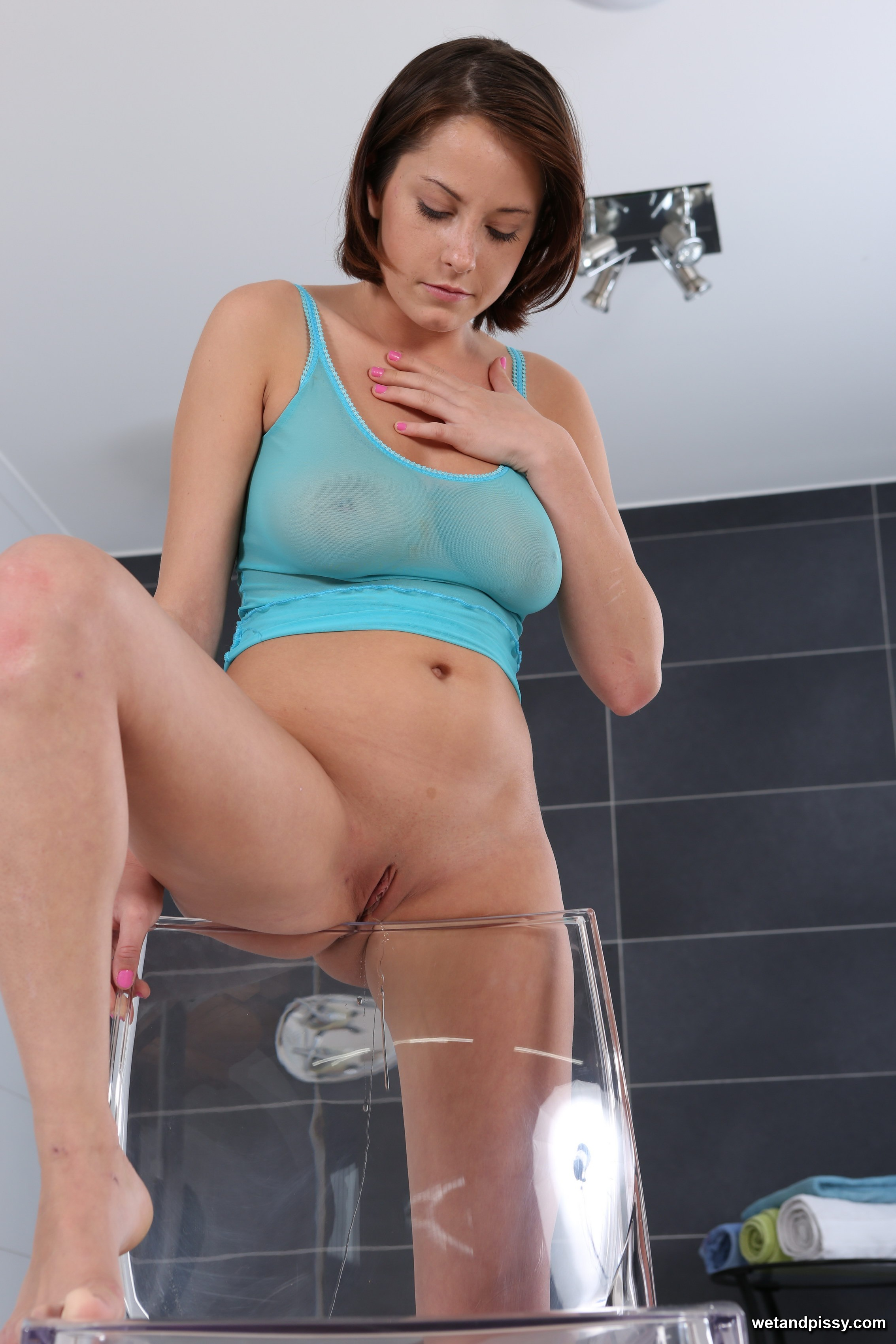 big boobed brunette pisses into a pussy pump