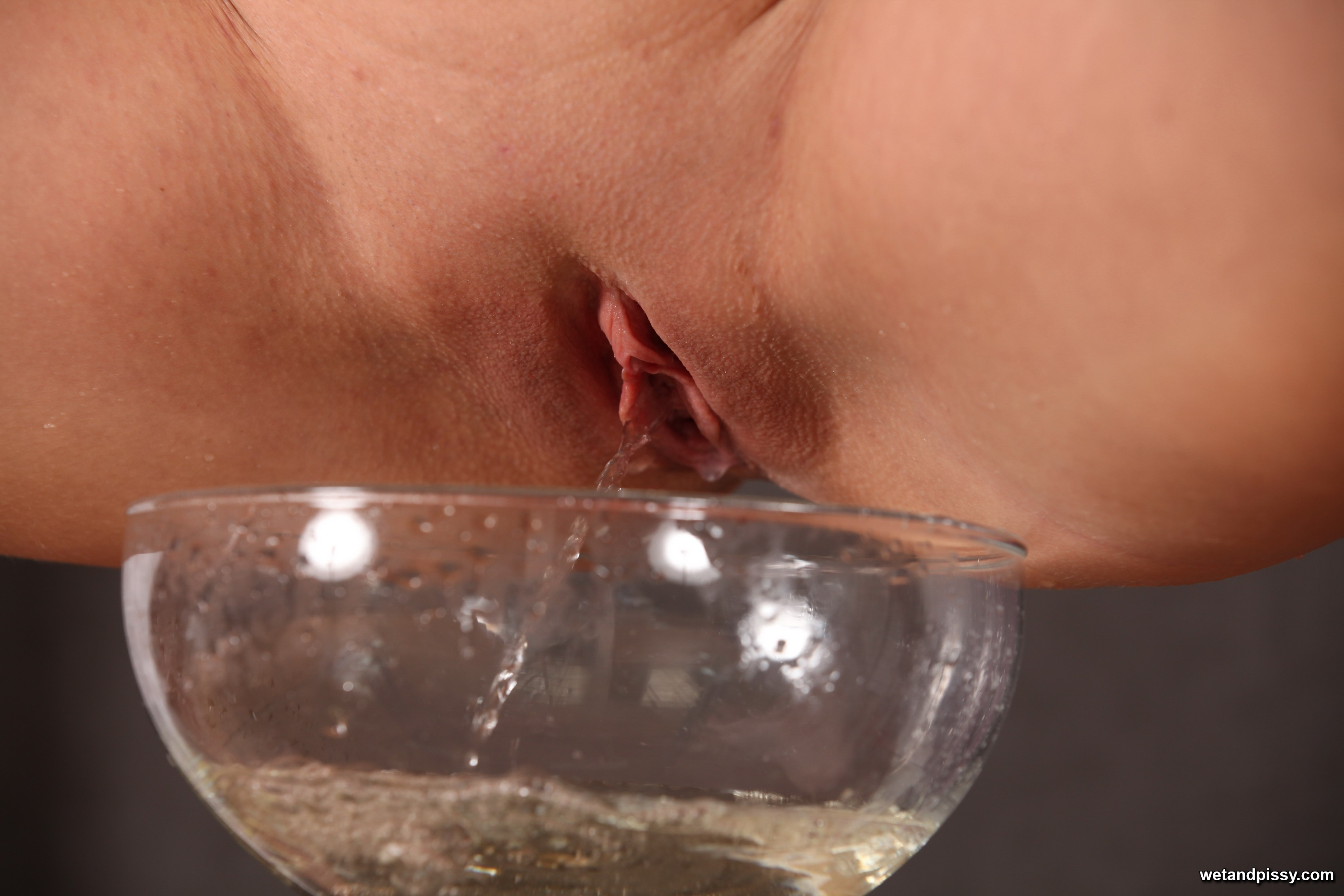 Perv brunette pee in the glass and then drinks it like water xxx porn photo